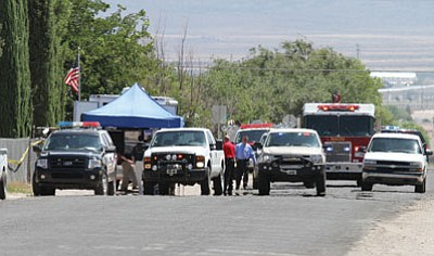 JC AMBERLYN/Miner<BR> The scene on Packard Avenue after a deputy shot and killed and 43-year-old man Friday morning.