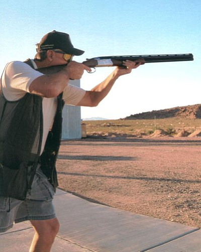 DON MARTIN/Special to the Miner<BR> Al Daum of Kingman sharpens up his shooting eye in preparation for the opening of dove season on Sept. 1 by shooting a round of skeet at the Mohave Sportsman Club's 7 Mile Hill Range.