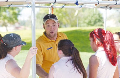 MATT HOLLINSHEAD/Miner<BR> Coach Ryan Gery talks with members of the Kingman High golf team before Monday's meet at Cerbat Cliffs Golf Course.