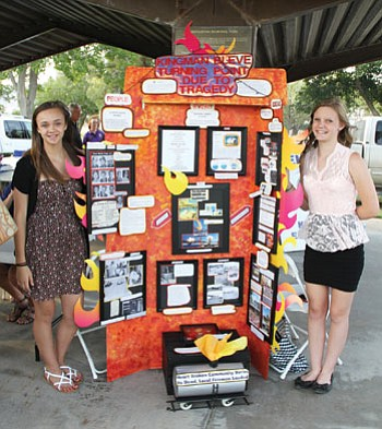 Olivia Diaz (left) and Avery Moon stand next to their National History Day project on the Doxol propane railroad tanker disaster, which occurred in Kingman on July 5, 1973. Eleven firefighters lost their lives. The display was shown at the 40-year memorial service held at Firefighters Park July 5. Diaz and Moon were in the seventh grade at the time they made it. They recently traveled to Maryland to participate in the NHD Nationals with this display and placed 10th. (JC AMBERLYN/Miner)