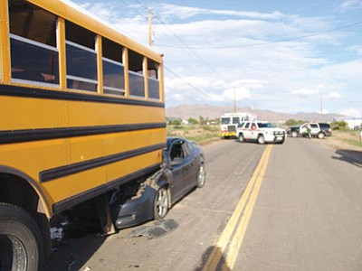 The driver of this car sustained moderate injuries after he rear-ended a school bus at about 4:40 p.m. Wednesday in Golden Valley. The four students on board and the bus driver were not injured. (Courtesy)