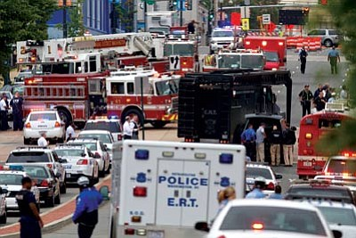 Emergency vehicles line the streets outside the Washington Navy Yard.<br> Associated Press