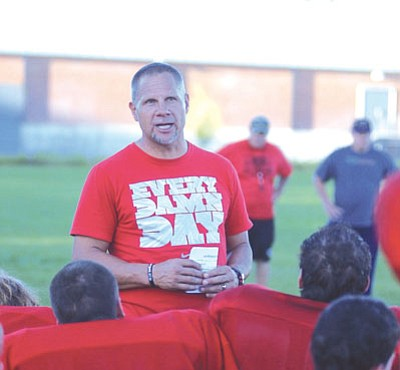 MATT HOLLINSHEAD/Miner<BR> Lee Williams head coach Eugene Kramer discusses the importance of starting with more urgency, getting better every game. The Volunteers did that in Friday's 26-0 win at Greyhills Academy.