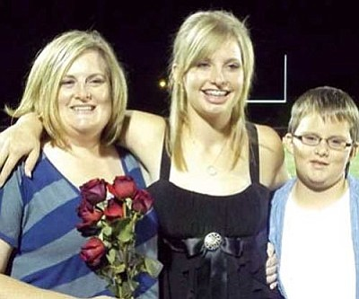 Courtesy<br /><br /><!-- 1upcrlf2 -->Theresa Jones, left, pictured with her children.