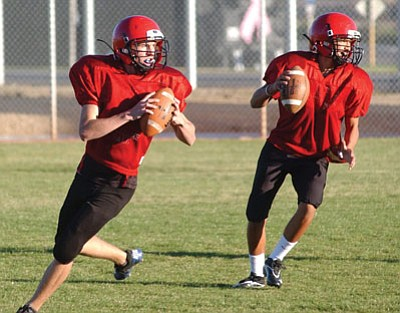 MATT HOLLINSHEAD/Miner<BR> Lee Williams sophomore quarterback Braxton Burgess prepares to throw at practice Tuesday afternoon. The Volunteers face Pinon at 7 p.m. today.