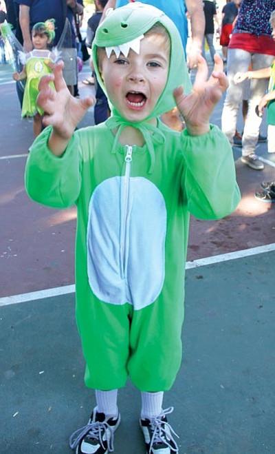 JC AMBERLYN/Miner<BR>Drake Gill, 4, poses as a dinosaur.