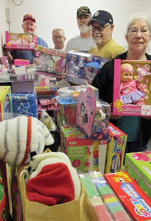 From left, Warren Brockman, Don Olin, Mike Breighner, Ray Theis and Cathy Breighner hold up some of the items that Toys for Tots will distribute to girls this year. (KIM STEELE/Miner)