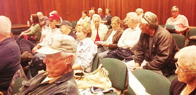 About 40 people opposed to a tentative proposal to seek a primary property tax in Kingman attended Tuesday's meeting. The City Council continues to look for a stable revenue stream. (DOUG McMURDO/Miner)