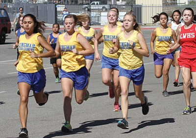 JC AMBERLYN/MINER<BR>Kingman High's girls cross country team runs during the Colorado River Region Championship Meet at Lee Williams Oct. 25. The Lady Bulldogs finished 28th at the AIA Division II State Meet Saturday.