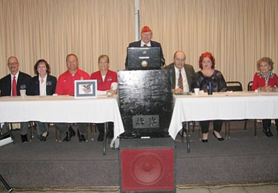 Courtesy<BR>To thank them for their service, the Kingman Elks Lodge No. 468 held a free breakfast for all local veterans and their spouses on Nov. 10 in the lodge dinning room located at 900 Gates Ave. Eighty-five veterans and their spouses attended. Shown seated at the dais are (left to right) Robert Taylor, Lodge Esquire; Kathy Taylor, Exalted Ruler; Michael Ward; state Sen. Kelli Ward; Richard Hardin, Lodge Veterans Committee Chairman (podium); Dorn Patrick Farrell, president, Jerry Ambrose Veterans Council; Casey Farrell; and Edna Vance.