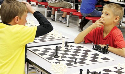 JC AMBERLYN/Miner<BR>Taylor West, 11, of Hualapai Elementary (left) shows some emotion as he and Levi Woods, 10, of Manzanita, play the fifth and final round of chess Saturday. They had both won the previous four rounds of chess. After a long game, Taylor prevailed.