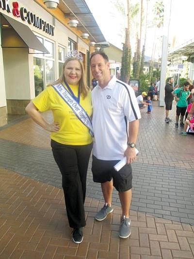 Courtesy<BR>Karista Harris with Arizona Diamondbacks legend Luis Gonzalez at a Make a Wish Foundation event in October.