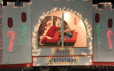 Santa Claus greets revelers at the downtown Kingman parade in 2011. (JC AMBERLYN/Miner)