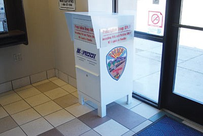 Workers recently installed this receptacle at the Kingman Police Department. It is available for residents to drop off unwanted, expired, or no longer required prescription medication. (Courtesy)