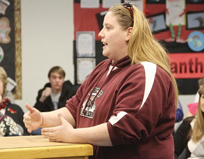 Trisha Jacobsen, a teacher from Kingman Middle School, speaks before the Kingman Unified School District Governing Board about the possibility of changing the district's calendar. (JC AMBERLYN/Miner)
