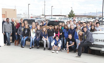 JC AMBERLYN/Miner<BR>KAHS students stand for a photo with the truck carrying away the food they donated.