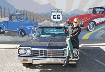 JC AMBERLYN/Miner<BR> Miss America 2013 Mallory Hagan and her mother visited family in Kingman for Thanksgiving and enjoyed a tour of downtown. She enjoyed the sights of Route 66, Kingman and the state. Here, she poses with a '64 Chevy Impala in front of the Sandy Rusinko mural on the Mohave Museum of History and Art building Thursday. Mallory held the Miss America crown from January to September of this year after competing as Miss New York 2012 (the length was shortened due to pageant scheduling and location changes).