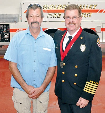 BUTCH MERIWETHER/Courtesy<BR> Robert Davies stands with Fire Chief Thomas O'Donohue at Golden Valley Fire District Station No. 11. Both have been recognized for their heroic lifesaving efforts on Dec. 21, 2012.