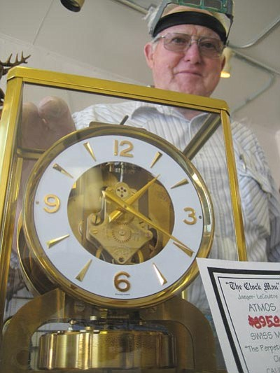 DOUG McMURDO/Miner<BR> Willis Lynes is one of the few clockmakers in the U.S. who is qualified to repair the Swiss made Atmos, a unique clock that is powered by the weather. It has been described as the closest thing to a perpetual motion machine that humans could design.