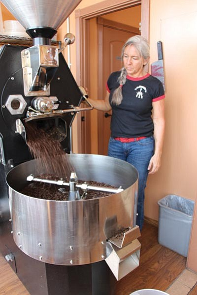 ALAN CHOATE/Miner<BR> Angela Patterson watches as the process of roasting coffee beans comes to an end at Beale Street Brews.