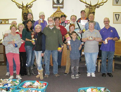 Courtesy<BR>Elks Lodge members deliver Christmas baskets to local families. Shown are 17 Kingman Elks Lodge volunteers who had just finished  packing Christmas baskets in the lodge meeting room for Kingman area families on Dec. 22. This year, the annual Christmas Basket event held by the Kingman Elks Lodge No. 468 involved 63 volunteers.