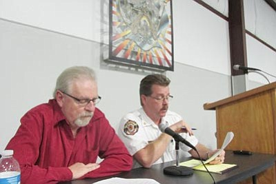 Golden Valley Fire District Chairman Mark Vanik, left, and Chief Tom O'Donohue address a town hall meeting Wednesday night. (DOUG McMURDO/Miner)
