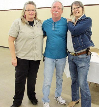 Three new board members were chosen Monday during the Mohave County Fair Association annual meeting. They are, from left, Teri Jack, James Bell and Jaime West. (KIM STEELE/Miner)