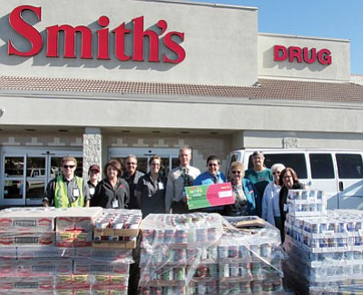 EVE HANNA/Miner<BR>Pictured from left to right are James Wilson, Shauna Johnson, Vicki Hutsell, Leonard Thomas, Savannah Gillespie, Donald Parker (Smith's assistant manager), Abdul Elawik (Smith's store manager), Betty Kahlor, Kim Turner (assistant director of the Kingman Food Bank), Mary Winchester (food bank volunteer) and Lisa Deuel (Smith's.)
