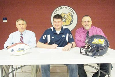 Kingman High's Rod Gilleo, center, signs a letter of intent to play football for Northern Arizona University.  Also pictured are KHS coach David Ward, left, and John Venenga, athletic director. (SHAWN BYRNE/Miner)