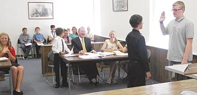 Participants in last summer's second Junior Police Academy held a mock trial in the courtroom of Kingman Municipal Court Magistrate Kathy McCoy. The event was one of many the cadets experienced. (JC AMBERLYN/Miner)