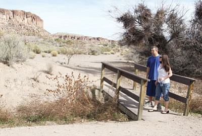 JC AMBERLYN/Miner<BR> Aaron and Candace Welch hike in Camp Beale Springs Tuesday.