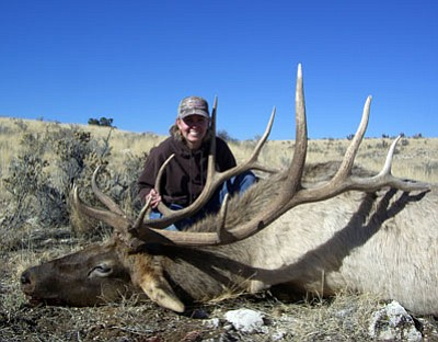 Special to the Miner<BR> Lacie Robbins shows the 7 X 6 bull she took on a late hunt in Unit 10.