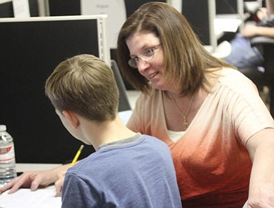 Kathy Roddy teaches a student at the Kingman Learning Center. (JC AMBERLYN/Miner)