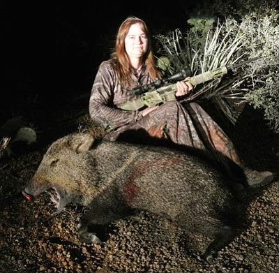Special to the Miner<BR>Peggy Ballard of Kingman shows the javelina – her first – that she bagged at the last minute of her general javelina hunt in Unit 16A.