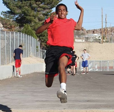 Lee Williams' McGregor Octave practices a jump recently at LWHS. Octave won the triple jump at Wednesday's meet in Lake Havasu.