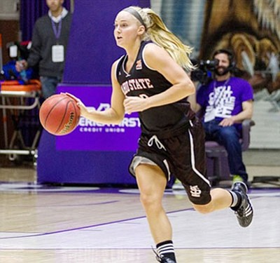 Courtesy/ISU Athletics<BR> Idaho State's Lindsey Reed (Kingman High, 2010) brings the ball up the floor against Weber State Feb. 17 at Ogden, Utah. Reed was named to the Big Sky Conference First Team by the coaches in the league on Monday.