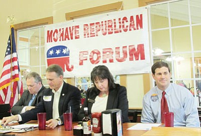 From left, Scott Smith, Gary Pierce, Michelle Reagan and Doug Ducey get ready for a meeting of the Mohave Republican Forum Wednesday. Pierce represented his son, Justin, who could not attend. (DOUG McMURDO/Miner)