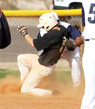 JC AMBERLYN/Miner<BR> Kingman Academy's Westin McCord beats the throw to third for a triple in Tuesday's win against Parker. KAHS whipped Bourgade Catholic 8-1 Saturday in Phoenix.