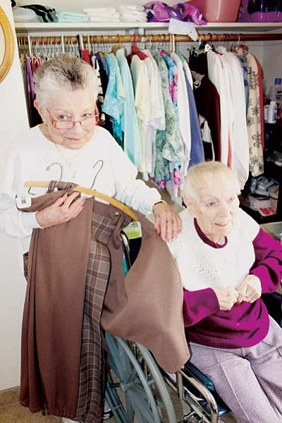DOUG McMURDO/Miner<BR> Marguerite Steele shows off the clothing items her mother, Irene Klein, made by hand. Irene will celebrate her 100th birthday March 30.