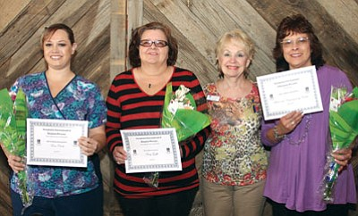 JC AMBERLYN/Miner<BR> Pictured from left are Women's Opportunity Award winners Terra Clark and Terry Griffis, Soroptimist president Beverly Mracek and Ruby Award winner Terese Reaume.
