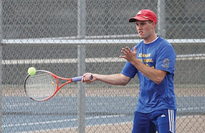 JC AMBERLYN/Miner<BR> Gregory Franklin punches a volley during singles play against Bradshaw Mountain Thursday at KHS.