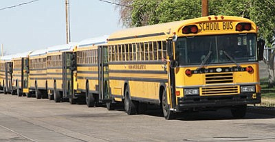 School buses wait at Kingman Middle School Tuesday afternoon. Education funding, and charter school funding in particular, is a contested subject in the Arizona Legislature. (JC AMBERLYN/Miner)