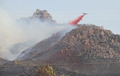 A tanker plane dumps fire retardant on last year's Dean Peak fire near Kingman. The ongoing drought has officials worried about this year's fire season in Arizona and across the West. (JC AMBERLYN/Miner)