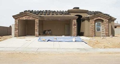 JC AMBERLYN/Miner<br /><br /><!-- 1upcrlf2 -->A home under construction on Robert Mitchum Drive in the Walleck Ranch subdivision, one of the more popular neighborhoods in Kingman.