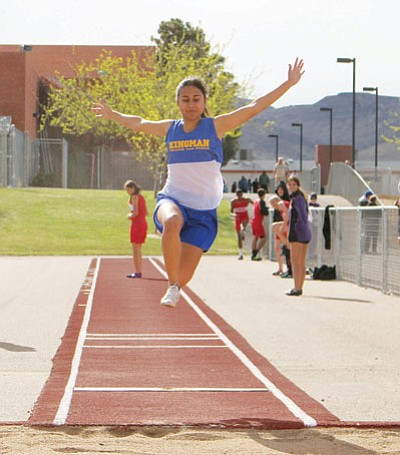 SHAWN BYRNE/Miner<BR> Paulina Delgado soars through the air in the long jump for Kingman High at last Wednesday's seven-team multi at KHS. Delgado won the event with a jump of 15 feet, 6.5 inches.