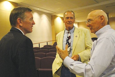 U.S. Rep. Paul Gosar, left, and Mohave County Supervisor Gary Watson, center, attended Monday's event. (MATT REINIG/Miner