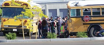 Several Kingman Middle School students went to Kingman Regional Medical Center Wednesday after a school bus rear-ended a passenger car at a low rate of speed. The injuries weren't serious, but the bus driver was issued a citation. (Courtesy)
