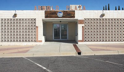 Mohave County's Arnold Plaza building once again received no bids when the county offered it for auction. County leaders consider the building too dilapidated to spend money on repairs. (JC AMBERLYN/Miner)
