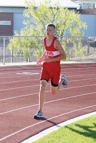 SHAWN BYRNE/Miner<BR> Brendon Allred takes a turn during the 3,200 meters at the Lee Williams Multiple April 16 at LWHS. Allred won that race and recently placed second at the seven-team Mohave Electric Invitational last Saturday in Bulhead City. Allred is currently ranked No. 32 in Division III and needs to climb up to No. 24 for the state championship meet. He's about 6.5 seconds behind that runner.