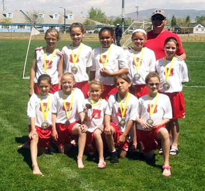Courtesy<BR>Pictured from left to right, top row: Kaytelynn Platko, Georgia Wise, Jaila Beaudoin, Sofia Mata-Miller, coach Gabe Otero, and MacKenzie Cathey. Bottom row: Berlynn Bratley, Grace Otero, Gwyneth Otero, Breeanna Lee, and Lyla Wise.
